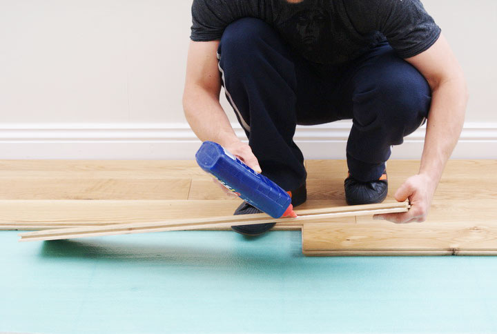 Application-of-PVA-Glue to wooden floorboard