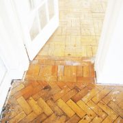Before parquet floor renovatin-door