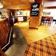 Distressed-oak-flooring-bar-area