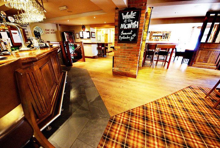 Distressed-oak-flooring-bar-area