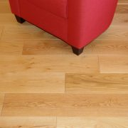 brushed and oiled oak floor with red chair