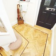 Rustic-parquet-floor-with-wenge-single-strip-border