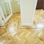 Rustic-parquet-floor-with-wenge-single-strip-border-doors