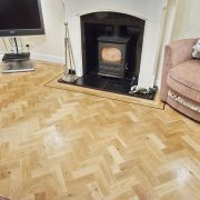 Rustic-parquet-floor-with-wenge-single-strip-border-fireplace