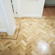 Rustic-parquet-floor-with-wenge-single-strip-border-hall