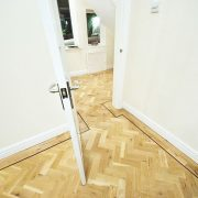 Rustic-parquet-floor-with-wenge-single-strip-door
