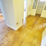 distressed-oak-floor-fitting-front-Door