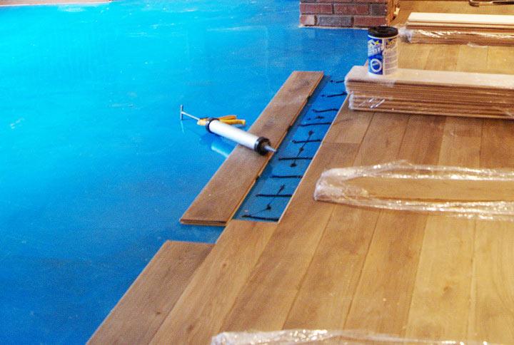 Gluing hardwood floors to concrete meze blog for Wood floor over carpet